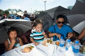 family of thousands feasts at annual honda center thanksgiving
