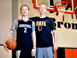 basketball player on bench braxton and drew haws back on bench together at senior boys