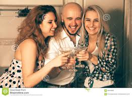 couple of beautiful ladies having fun with a guy at a party with