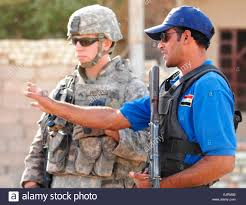 an iraqi officer shows cpl randall robinson from charleston