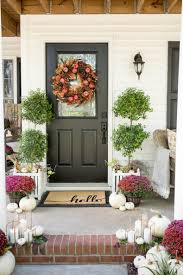 painting your front door the easy way the diy village plum and red mums fall porch home stories a to z