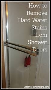 removing hard water stains on shower doors