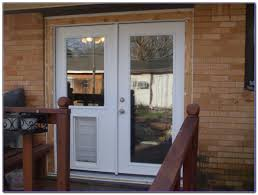 sliding patio door with pet door built in patios home design