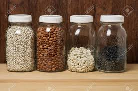 glass canisters kitchen beans stored in glass canisters in the kitchen stock photo
