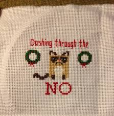my presents this year cat cross stitches grumpy cat and