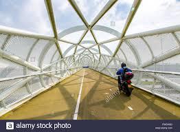 modern architecture bike path and footbridge de groene