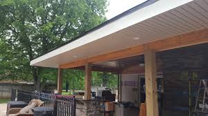 joe m staub building group covered patio with outdoor kitchen