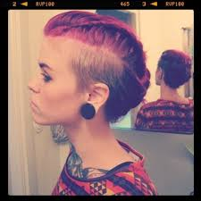 braids with half shaved head long hair shaved sides shaved side with long braided updo