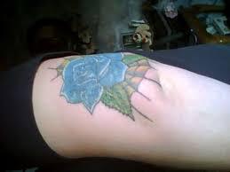 simple blue rose and spider web tattoo on elbow tattooshunter com