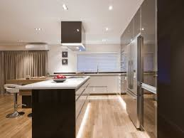 cove lighting white countertop kitchen cabinets wood floor tray