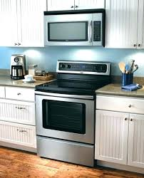 microwave with extractor fan whirlpool wmh31017ab 1 7 cu ft over the range microwave oven with