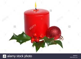 christmas candle with holly and ornament cut out isolated on white