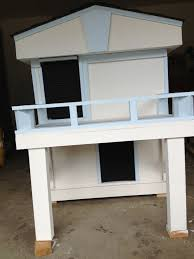 2 story dog house with inside stairs and upstairs balcony my