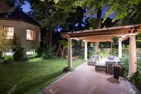 photo of garden with covered patio at night stock photo picture
