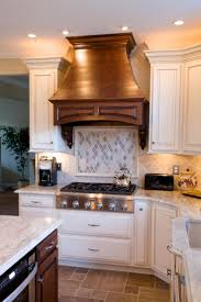 228 best granite images on pinterest kitchen kitchen cabinets kashmir gold granite countertops with natural stone backsplash tile and cream cabinets kitchen by stoneshop from cherry hill nj