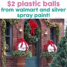 2 plastic balls from walmart and spray them with silver spray
