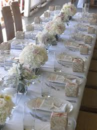 luxuriously white beach theme wedding tablescape weddings at
