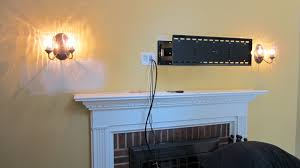 mount tv above fireplace no wires fireplace design and ideas