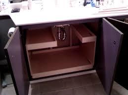 sublime under bathroom sink organizer with brown wooden door