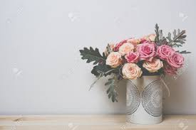Simple Home Interior Bouquet Of Pink And Beige Roses In A Decorative Vase On A Shelf