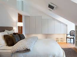 bedroom vintage attic design with white king sized bed also