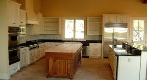 are painted or stained kitchen cabinets in style traditional kitchen with painted perimeter cabinets with