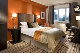 What Color Goes With Orange Walls Striking Bedroom With Orange Wall Colors Warm Bedroom Colors For