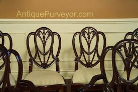 set of 8 to 12 sweetheart shield back dining chairs