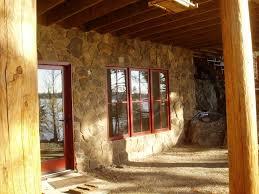 cedar log lake home set in hillside u2013 huisman concepts