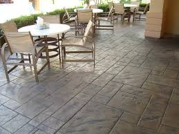 decorating some patio furniture on stamped concrete patio for