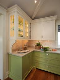 nice looking light green kitchen cabinets with mounted in the