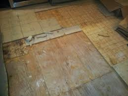 Can I Tile Over Laminate Flooring Installing Snapstone Kitchen Floor Tile For Our Home Remodel Ian