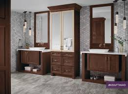 with floor to ceiling linen cabinets and two vanities this