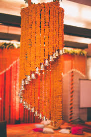 floral chandelier made of orange marigold and bells perfect add
