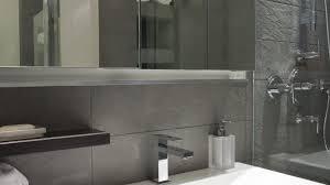 light gray bathroom walls bright hardwood flooring shapely vanity