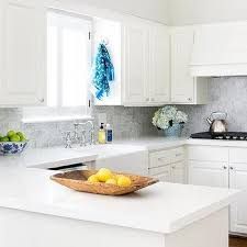 antique white kitchen cabinets with subway tile backsplash white cabinets with white backsplash design ideas