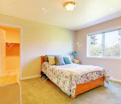 Blue And Beige Bedrooms by Small Bedroom With Simple Bed And Blue Pillows And Beige Walls