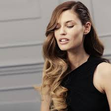 a side part with long hair and a swoop and a cross deep side part hairstyles hair world magazine