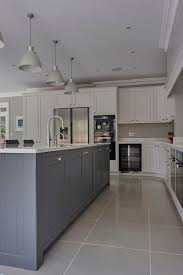 dark grey kitchen floor tiles walls and white cabinets yellow