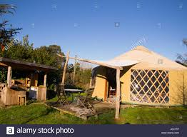 a beautiful yurt and outdoor kitchen on a sunny day in rural new