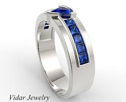 blue titanium wedding band men s wedding band trillion cut blue sapphire unique wedding band