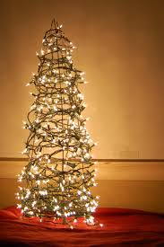 christmas tree decoration made with bent coat hanger wire and