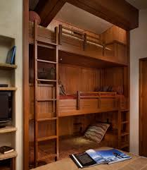 built in bunk beds for a rustic bedroom with a reading light and
