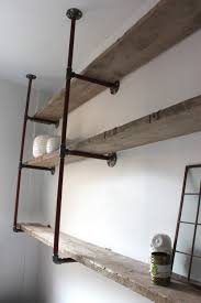 reclaimed scaffolding boards and steel pipe wall mounted shelving