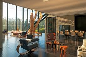 stylish living room opens onto a double height sitting area