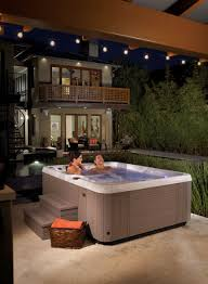 come to life in this kauai hottub from caldera spas backyard