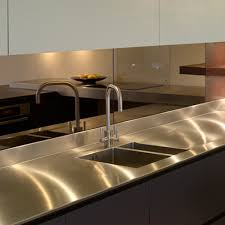 smoked mirror backsplash laundry room stainless steel countertop with integrated