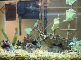 ideas for aquarium décor with white walls http modtopiastudio
