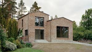 hermansson hiller lundberg designs staggered brick house in sweden