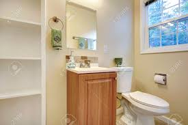 bathroom built in shelves light tones bathroom with french window view of washbasin cabinet